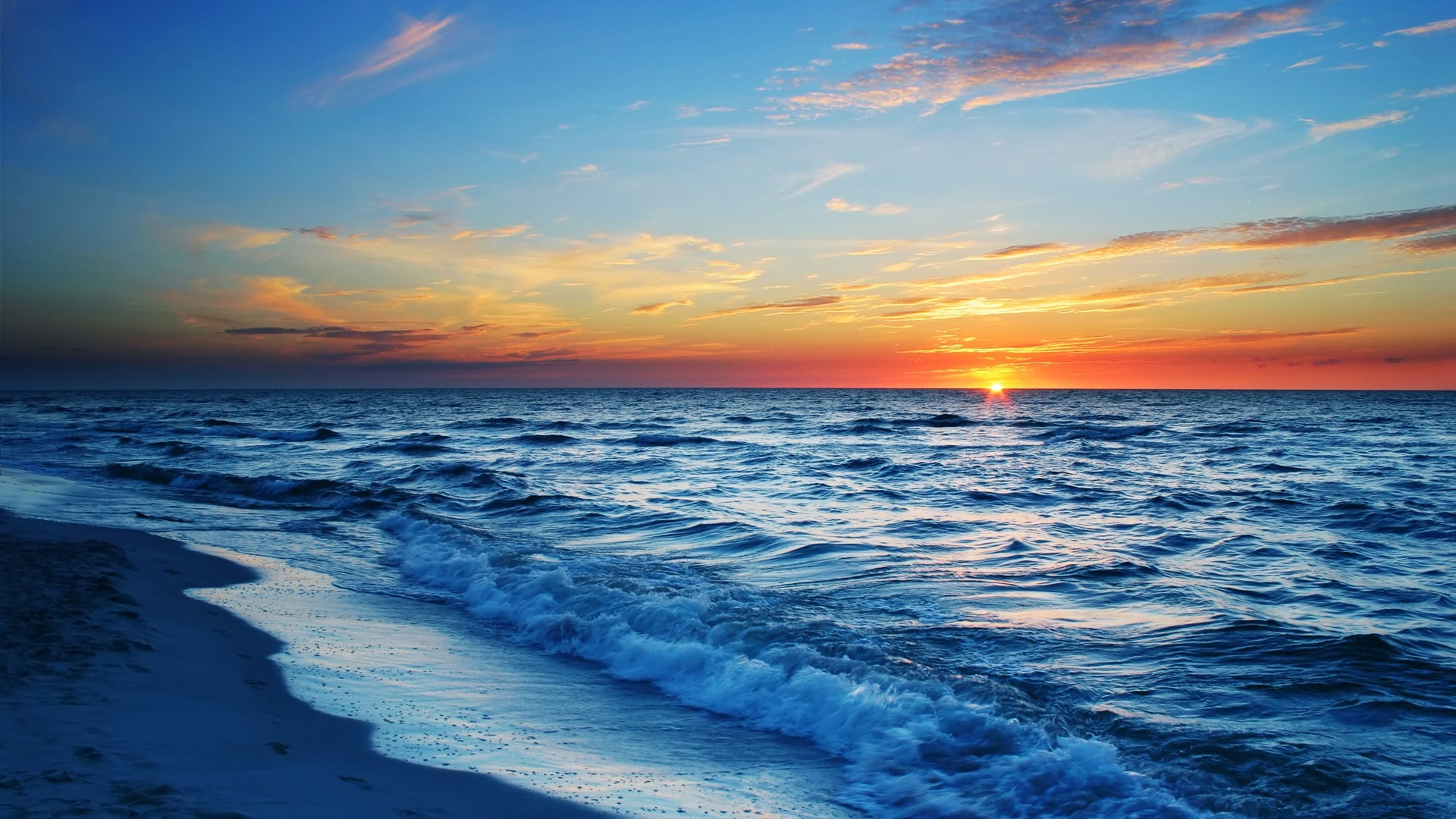 Sunset-sea-beach-waves-blue-orange-sky_1920x1080
